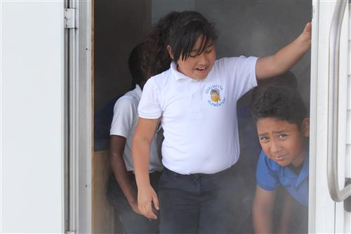 Students learned what to do in a house fire.
