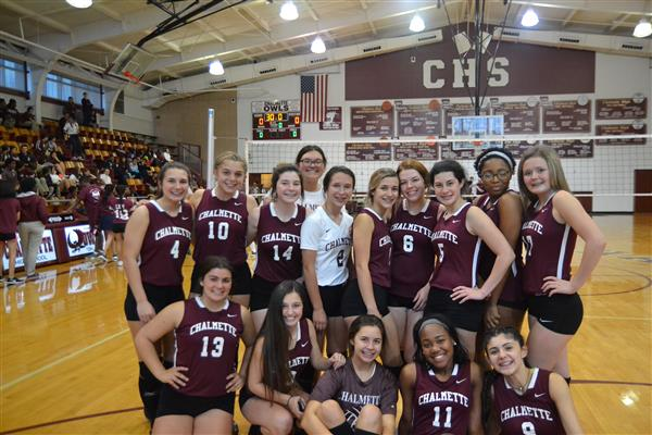 Volleyball team photo in CHS gym