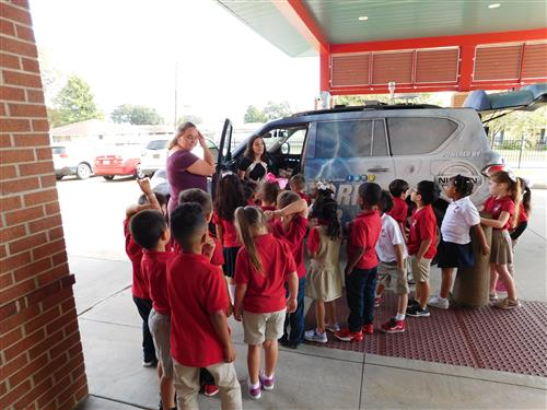 Ms. Clark's Kindergarten class learns about the Fox 8 weather car.