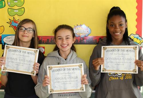 November's three students of the month.