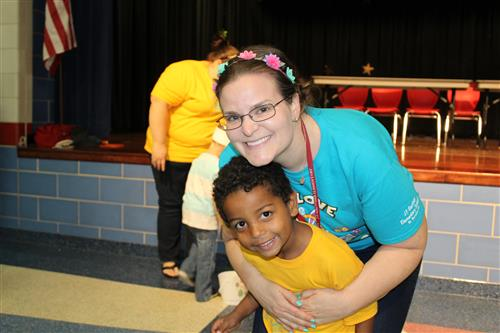 Carly Brandy is hugs one of her Pre-K 4 students
