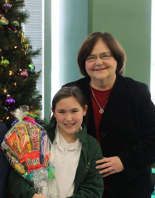 Robyn Hays with Superintendent Doris Voitier holding a candy bouquet.
